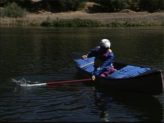 Rolling a Solo Whitewater Canoe